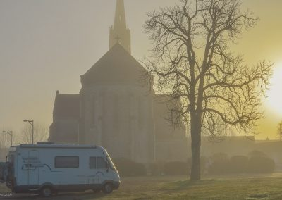 Morning mist round church in France