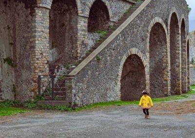 Pompeii - child in yellow coat