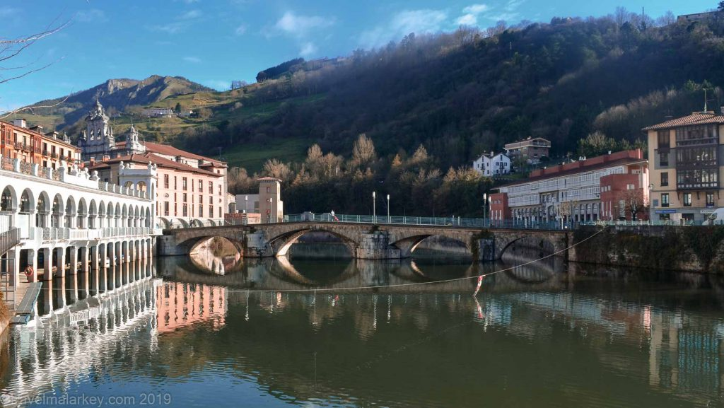 Historic Tolosa reflections in river